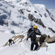 Rope work on alpine ridge climb