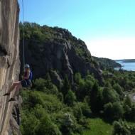 Maria rappelling down Ulorn crag