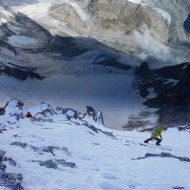 Snowy conditions on the Lion Ridge, Mike and Morgon pitching their way up