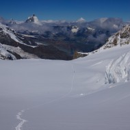 Team coming up from Monte Rosa Hutte in the distance