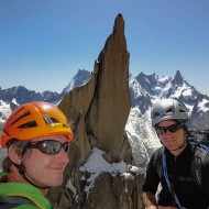 We have reach the ledge where the route traverses left, behind the summit of Aig de Roc