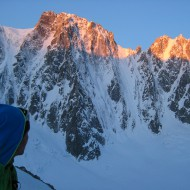 First morning light on north east facing mountain side of the Argentiere basin, we are already skinning