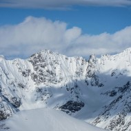 Skiers on Rornaestind, Kjostind behind