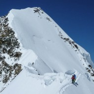 We are down the steepest part of this exposed snow ridge