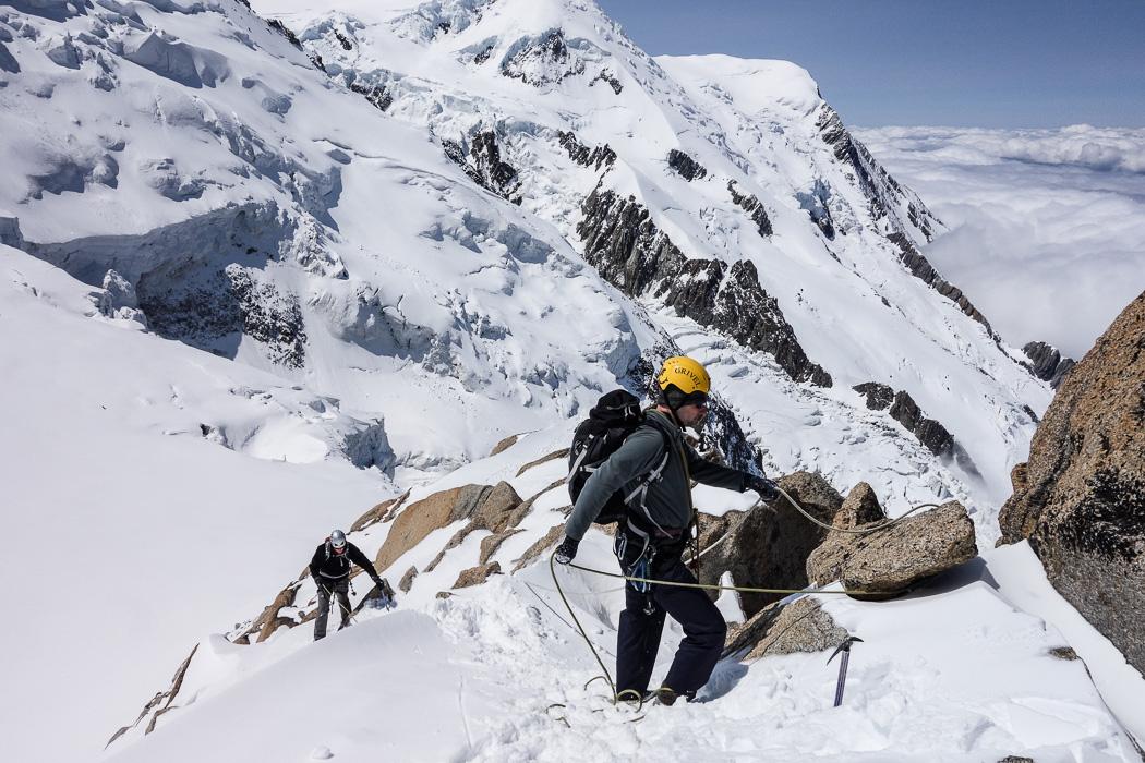 Rope work on alpine ridge climb