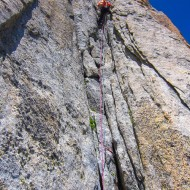 Trverse back right aiming for Breche Balfour. The last 2 pitches up to the breche are challenging, a steep dihedral, then a final short but difficult wide-crack corner section that once again reminds you how creative and skilled climbers were back in 1911
